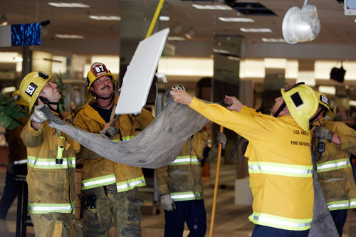 Los Angeles City Firefighters work to remove water from the Macy's department store in Woodland Hills, Ca. A six-inch water main broke on the third-floor causing water to run down to the first and second floors. Sixteen engine companies responded to remove four to six inches of water on the floors and salvage merchandise. The cause of the break was believed to be the magnitude-5.4 earthquake that was centered 29 miles southeast of downtown Los Angeles near the city of Chino Hills.(Hans Gutknecht/LA Daily News)