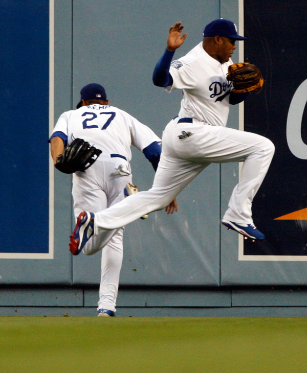 Los Angeles Dodger Andruw Jones #25 jumps to avoid Dodger Matt Kemp #27 as Kemp catches a fly ball hit by Washington Nationals' Austin Kearns in the during their game at Dodger Stadium Friday, July 25, 2008.  (Hans Gutknecht/LA Daily News)
