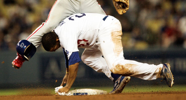 Los Angeles Dodgers' Matt Kemp can't break up the double play as Philadelphia Phillies' second baseman Chase Utley throws to first base in the the seventh inning. (Hans Gutknecht/Daily News)