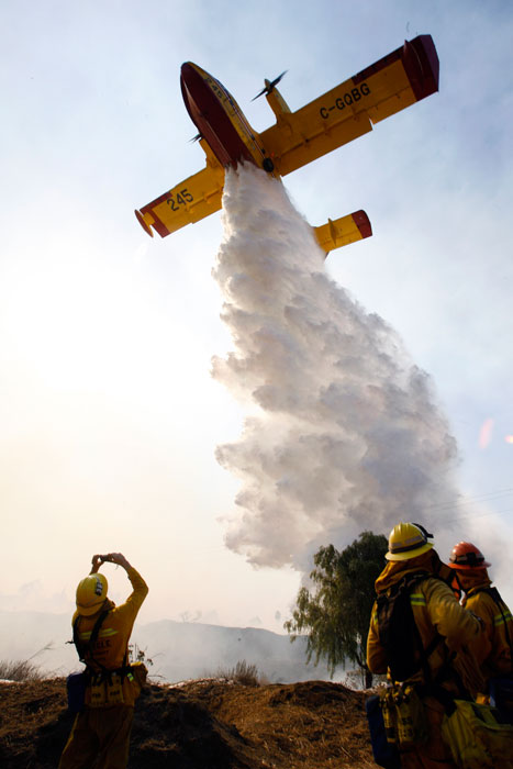 A Super Scooper makes a water drop on flames in the Sylmar area of Los Angeles Monday, October 13,2008. Fires burned thousands of acres and destroyed several structures fueled by strong winds. (Hans Gutknecht/Staff Photographer)
