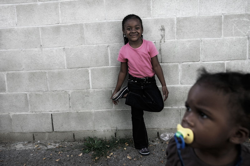Nayasa Hills, 6-years-old, plays with her sister Bra'enysa Davis, 2-years-old, outside of their North Hollywood apartment Tuesday, December 9, 2008.  The girls mother Bernice Davis, a single mother, became homeless in 2006 after she could no longer afford a rented room at a friend's home. In the ensuing months, she exhausted her savings while staying with family and friends and ultimately sought refuge at a Skid Row mission. Discovered by Los Angeles County's Skid Row Outreach Team, Davis was referred to Beyond Shelter, which relocated her family to a hotel within 24 hours. Within a few months, the nonprofit agency helped her move into a two-bedroom apartment in North Hollywood and obtain a Section 8 voucher to continue paying the rent. With only an 11th grade education, Davis is now attending adult school to obtain her GED and is working toward becoming self-sufficient again. The outreach team and Beyond Shelter have helped Davis and 234 other homeless families, including about 700 children and 300 adults obtain permanent housing and services and get off the dangerous streets of Skid Row. (Hans Gutknecht/Staff Photographer) 