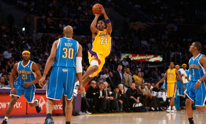 Los Angeles Lakers' Kobe Bryant hits a a long three point shot as time expires in the first half against the New Orleans Hornets during their NBA game at the Stales Center in Los Angeles CA. January 6, 2009. (Hans Gutnecht/Staff Photographer)