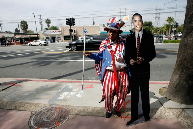 Jetset Hudson, Pasadena, holds a life size cutout of the president as people wait in line to get in to NBC studios in Burbank, CA to see President Barack Obama on The Tonight Show with Jay Leno Thursday, March 19, 2009.   (Hans Gutknecht/Staff Photographer)