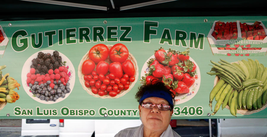 Francis Burciaga waits for customers at the Gutierrez Farms stand at the at the Sherman Oaks  farmers market. (Hans Gutknecht/Staff Photographer)
