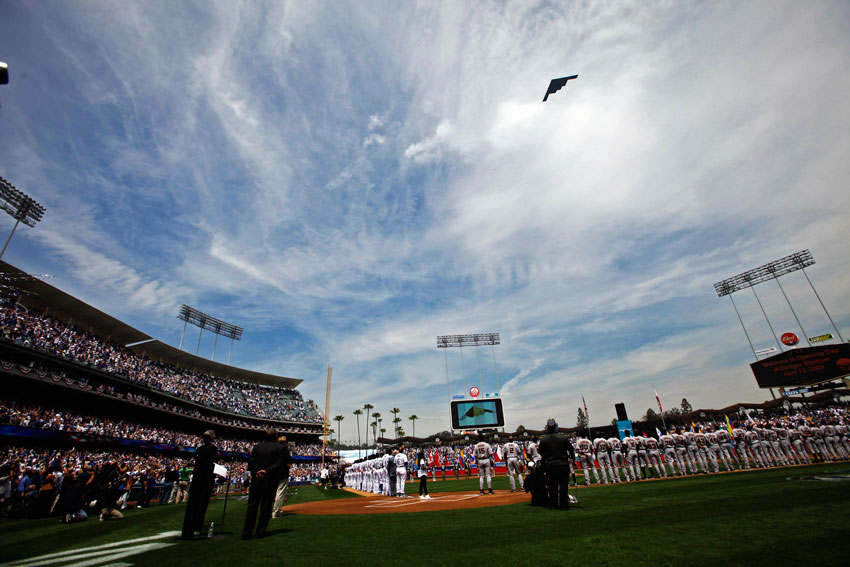 A B-2 bomber does a fly over during opening day ceremonies at Dodger Stadium in Los Angeles Monday, April 13, 2009.  (Hans Gutknecht/Staff Photographer)