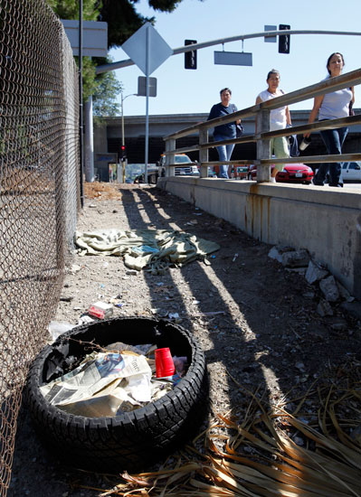 Trash litters the side of the road on Van Nuys Blvd. at the Ventura Freeway.  (Hans Gutknecht/LA Daily News)
