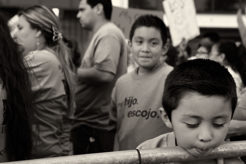 Brian Del Rio, 6-years-old, rests his head on a fence during a rally outside the  Los Angeles Unified School District headquarters in Los Angels. The rally was held to support a LAUSD resolution that would that would invite private charter school operators, local communities and even the mayor's office to submit proposals for operating 50 new schools as well as 200 existing underperforming schools. (Hans Gutknecht/LA Daily News) 