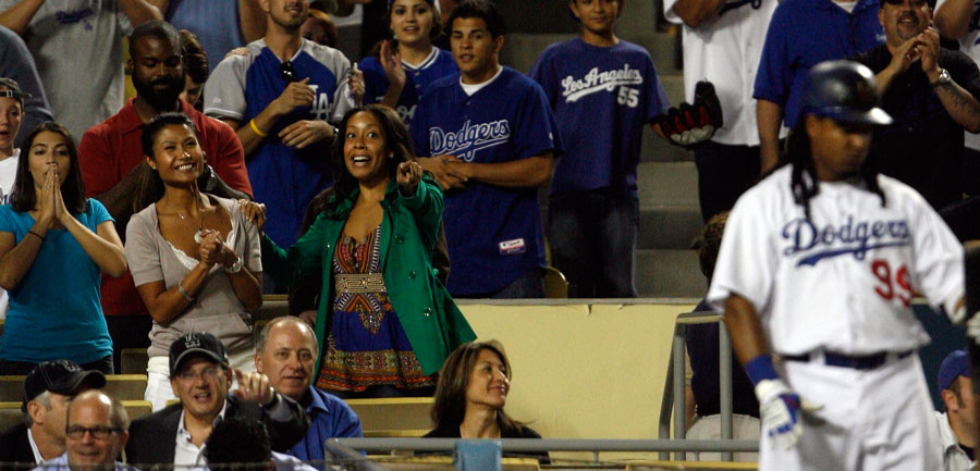 Fans leave their seats as Los Angeles Dodgers' Manny Ramirez #99 walks to the plate with the bases loaded in the bottom of the 9th inning during their game against the Milwaukee Brewers at Dodger Stadium Monday, August  3, 2009. The Brewers beat the Dodgers 6-5. (Hans Gutknecht/LA Daily News)