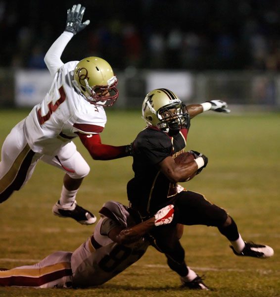 Alemany High School's Malcolm Marable #2 picks up some yards as  Oaks Christian High School's Brian Fifita #3 and Silas Goma #83 attempt to make the tackle during their football game at Alemany High School Friday, September 4, 2009 in Mission Hills, CA.  (Hans Gutknecht/LA Daily News)