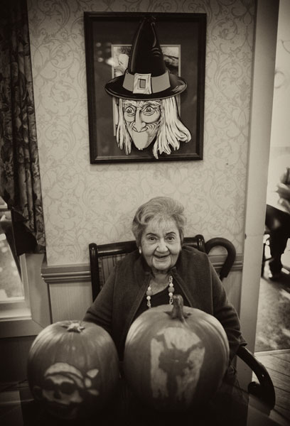 Beatrice Sommers takes a look at a pair of carved pumpkins. Taft High School students from Linda Tamshen's advanced art class visited Sunrise Assisted Living Facility in Woodland Hills bringing the residents pumpkins that they carved as part of class project. (Hans Gutknecht/LA Daily News)