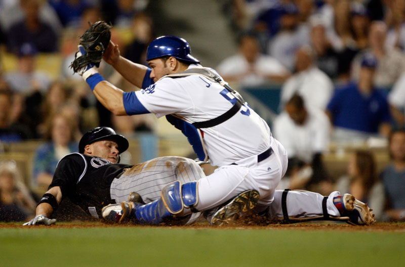 Los Angeles Dodgers catcher Russell Martin #55 tags out Colorado Rockies' Clint Barmes #12 at home plate in the 4th inning during their game at Dodger Stadium Friday, October 2, 2009. (Hans Gutknecht/LA Daily News)