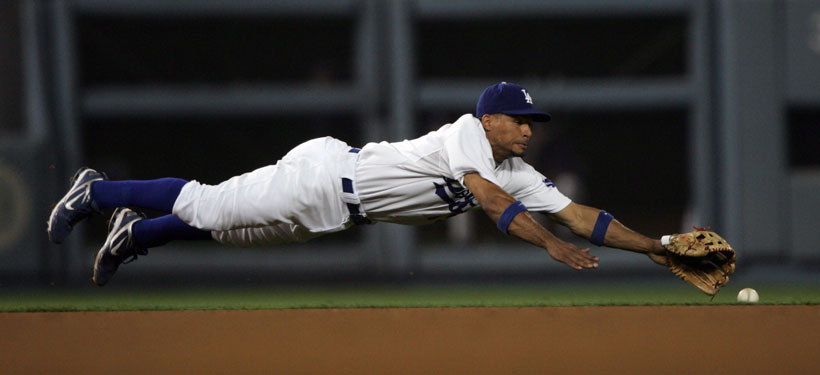 Los Angeles Dodgers's Rafael Furcal #15 dives for a Philadelphia Phillies' Jimmy Rollins #11 base hit in the 7th inning during game one of the NLCS at Dodger Stadium Thursday October 15, 2009 in Los Angeles CA (Hans Gutknecht/LA Daily News)