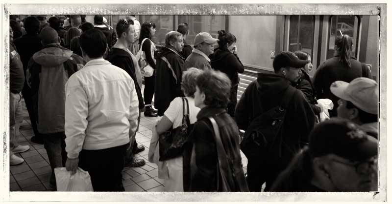 People crowd the Metro Red Line station in North Hollywood. (Hans Gutknecht/Staff Photographer)