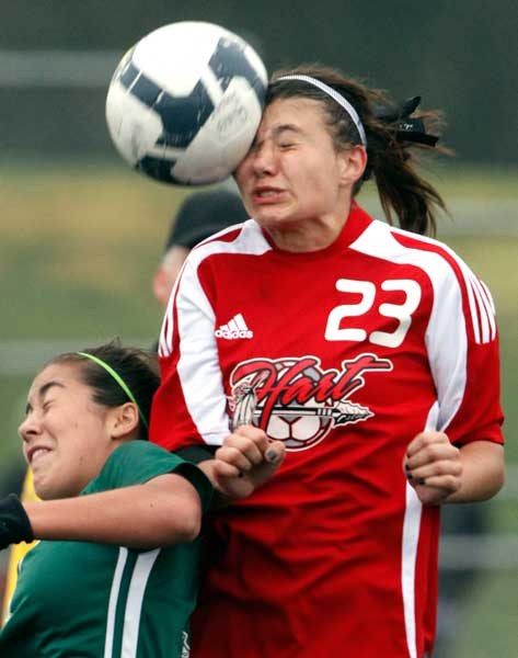 Hart High School's Kelsey Steck #23 heads the ball as Canyons High School's Nichole Guerro #3 defends during the Hart Soccer Tournament girls final at Hart High School in Newhall, CA Wednesday December 30, 2009. (Hans Gutknecht/Staff Photographer)