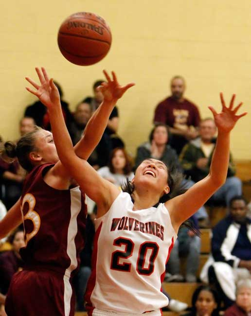 Harvard-Westlake High School's Nicole Hung #20 is fouled by  Alemany High School's Angelica Sahagun #23 during the West Coast Holiday Invitational girls basketball tournament championship game at Harvard Westlake High School in  Studio City, CA Thursday December 31, 2009. (Hans Gutknecht/Staff Photographer)