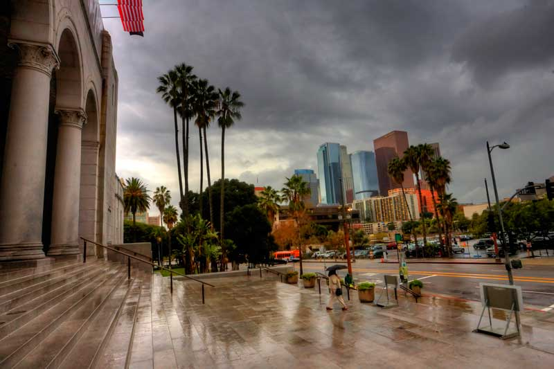 The steps of Los Angeles City Hall under cloudy skies.