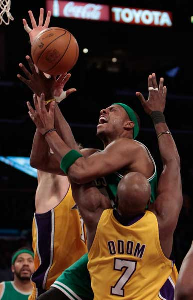 Boston Celtics' Paul Pierce #34 gets tangled up with Los Angeles Lakers' Lamar Odom #7 as he attempts a shot in the second half during their game at the Staples Center in Los Angeles Thursday, February 18-1010.  The Celtics beat the Lakers 87-86. (Hans Gutknecht/Staff Photographer)