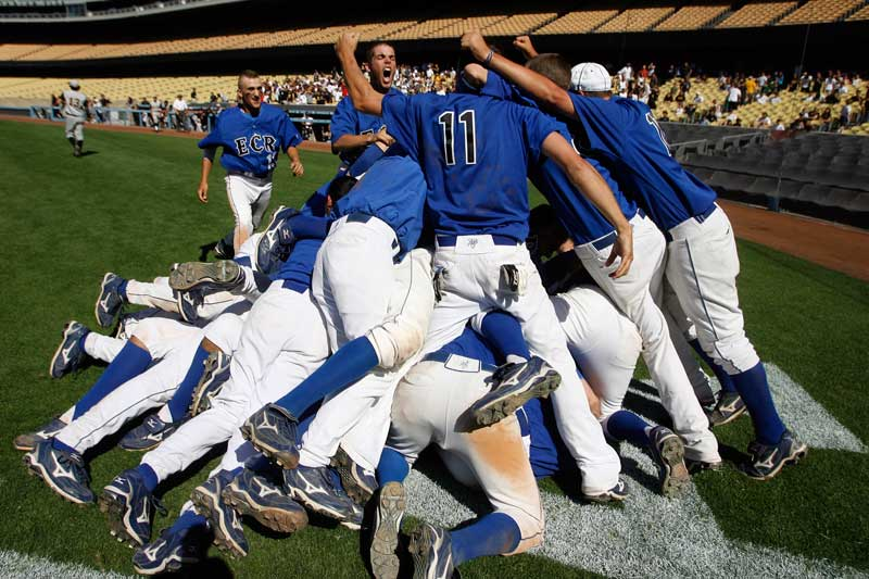 El Camino Real players celebrate their victory over San Pesro to win the CIF City Section Division I championship game at Dodger Stadium in Los Angeles.  (Hans Gutknecht/Staff Photographer)