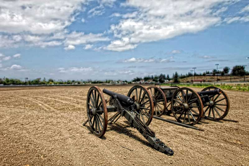 A pair of cannons sit in a field at Pierce College. A Civil War Re-enactment will be held at the college Saturday and Sunday. (Hans Gutknecht/Staff Photographer)