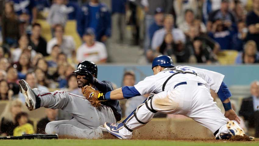 Atlanta Braves's Jason Heyward #22 beat the tag of Los Angeles Dodgers catcher Russell Martin #55 to score in the seventh inning at Dodger Stadium Saturday, June 5, 2010.  (Hans Gutknecht/Staff Photographer)