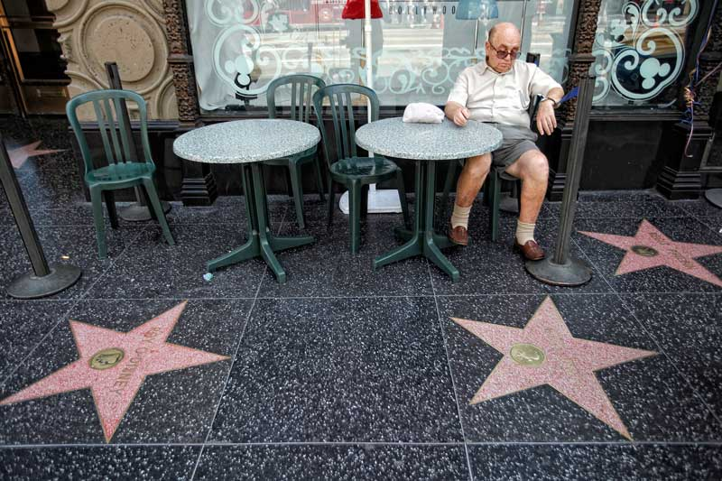 Edward Parilis, Long Beach, takes relaxes on Hollywood Blvd.