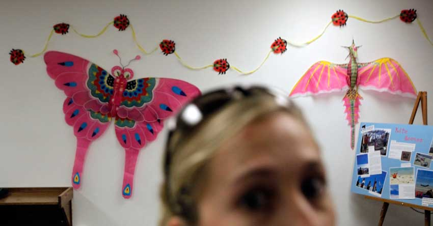 Marine biologist graduate student Jennifer Granneman walks past kites on display in the Oviatt Library Lobby on the CSUN campus in Northridge. An exhibit of kites entitled 'Floating on Air' will be on display at the library until August 13, 2010.  (Hans Gutknecht/Staff Photographer)