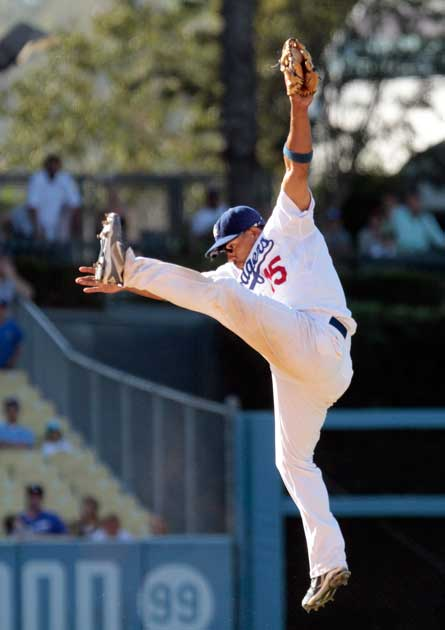 Los Angeles Dodgers shortstop Rafael Furcal (15) makes a leaping catch on a New York Mets' Ike Davis (29) line drive for the out in the 13th inning during their game at Dodger Stadium in Los Angeles Saturday, July 24, 2010. (Hans Gutknecht)