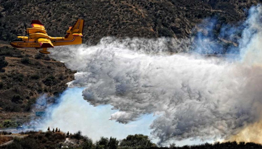 Firefighting aircraft battle a blaze along Sierra Highway Saturday, October 9, 2010 in Newhall, CA . (Hans Gutknecht/Staff Photographer)