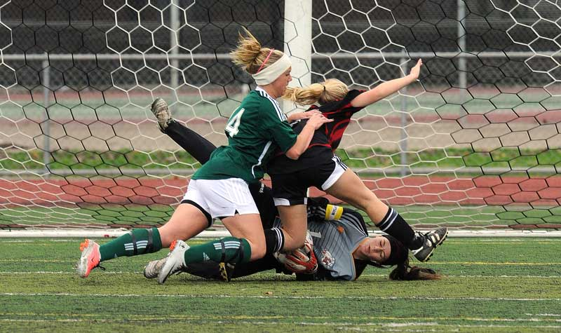 Hart goalie Kayce Perkins makes a save during the Hart Soccer Tournament championship game against Canyon Wednesday, December 29, 2010 at Hart High School in Newhall, CA. (Hans Gutknecht/Staff Photographer)