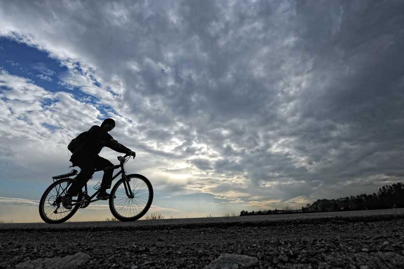 A bicyclist makes his way along the top of Hansen Dam under cloudy skies in Lake View Terrace Friday, December 7, 2011. (Hans Gutknecht/Staff Photographer)
