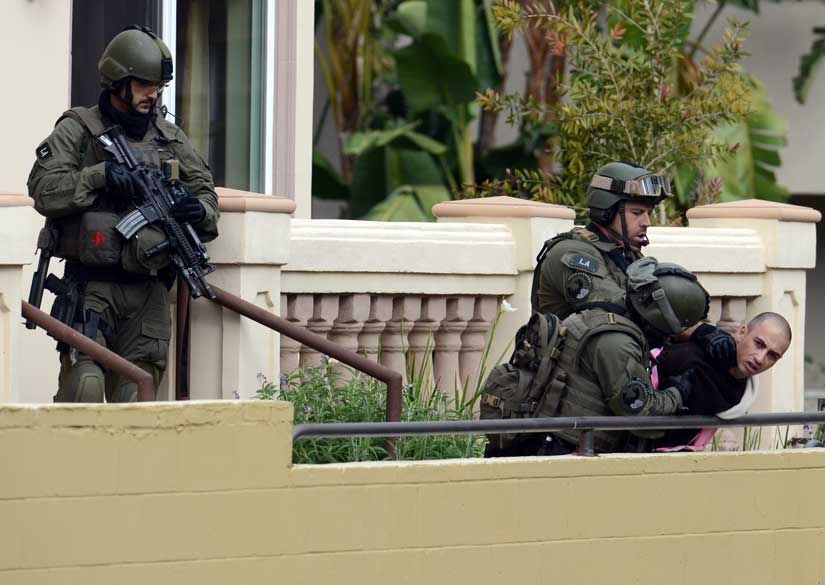 FBI SWAT team members arrest a man after storming a townhouse in the 4300 Stern Ave in Sherman Oaks Wednesday, February 15, 2011.