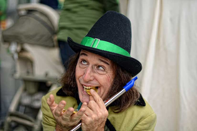 John Mackee, dressed as a leprechaun, entertains the crowd  during the Canoga Park St. Patrick's Day Community March & Celebration . (Hans Gutknecht/Staff Photographer)