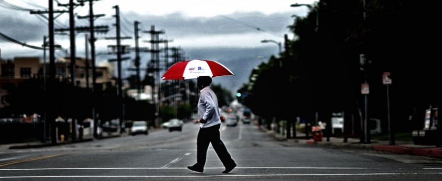 A pedestrian crosses Corbin Ave at Plummer St Tuesday, May 17, 2011. (Hans Gutknecht/Staff Photographer)