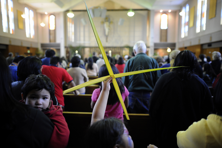 Parishioners hold palms during services at Our Lady of the Valley Roman Catholic Church in Canoga Park Saturday, March 31, 2012. Palm Sunday, April 1, recalls Jesus' entry into Jerusalem and is the beginning of Holy Week for Christians and includes Good Friday, April 6, and Easter, April 8. (Hans Gutknecht/Staff Photographer)
