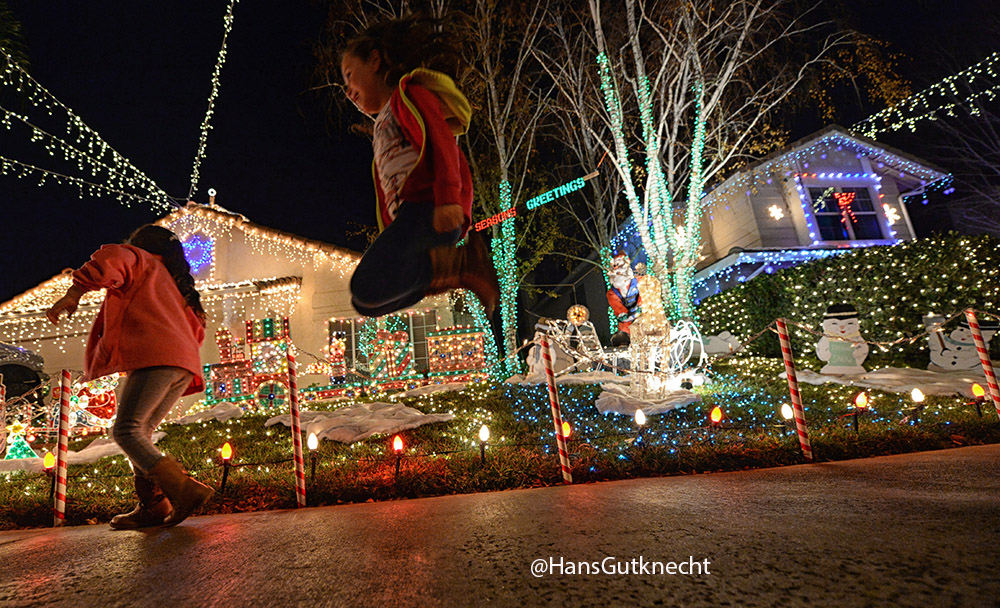 molly ibarra 7 years old jumps while looking at christmas lights on